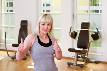 personal trainer motivated with thumbs up Stock Photo - 14209609
