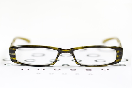 farsighted: glasses on the background of eye test chart