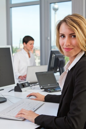 young women at the workplace in the office photo