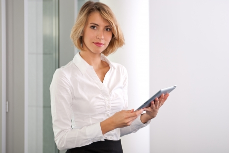 delighted: Businesswoman with tablet pc Stock Photo