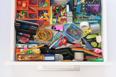 staple gun: Elevated view of front  sides of full stationery drawer