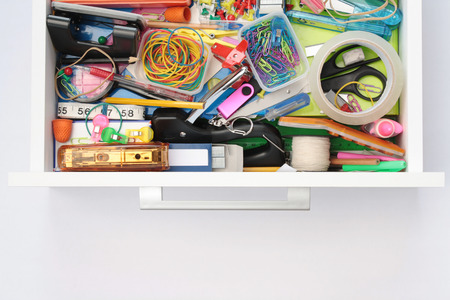 staple gun: Elevated view of front  sides of stationery drawer with copy space