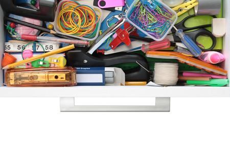 staple gun: Elevated view of the colourful contents of the stationery drawer Isolated on white Stock Photo