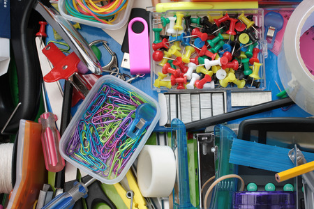 staple gun: Elevated close-up view of the colourful contents of the stationery drawer