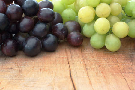 Green & black grapes on an outdoor table