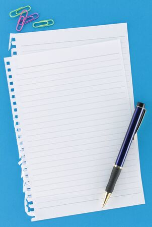 Overview of notepaper on background with pen blue