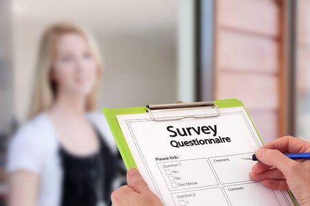 Happy girl answers questions during a door to door survey interview