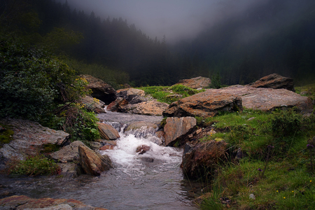 Mystic lanscape with a stream.