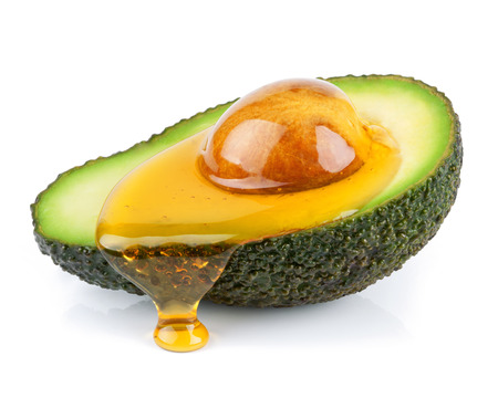 isolated avocado with honey