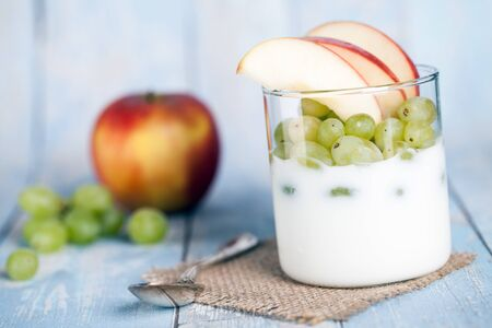 quark: yogurt with apples and grapes Stock Photo