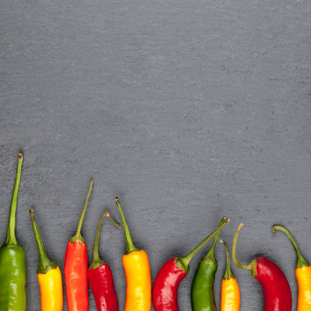 gourmet kitchen: black background with colorful chili peppers