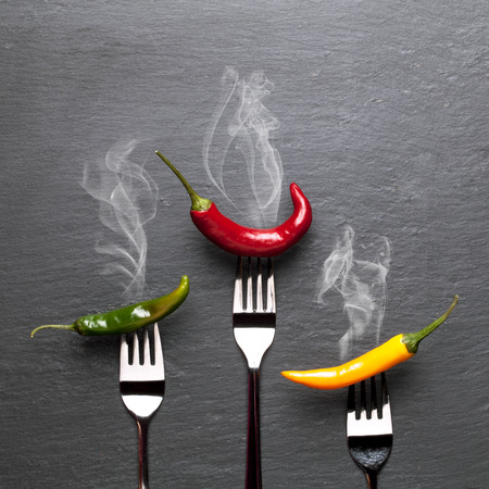 steaming: Steaming colorful chili peppers