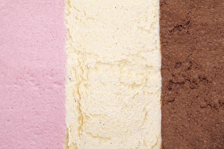 cream color: ice cream background with strawberry, vanilla and chocolate Stock Photo