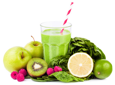 smoothie: green smoothie with fruits and vegetables on white background Stock Photo
