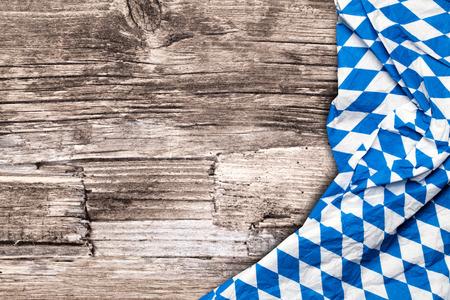 Bavarian Oktoberfest tablecloth on a wooden table Foto de archivo