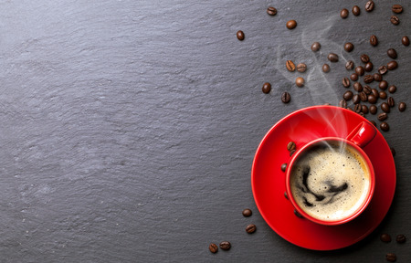 morning coffee: coffee cup with coffee beans background