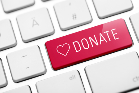 donate key on keyboard Banco de Imagens