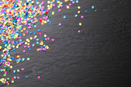 colorful confetti blackboard background Banco de Imagens