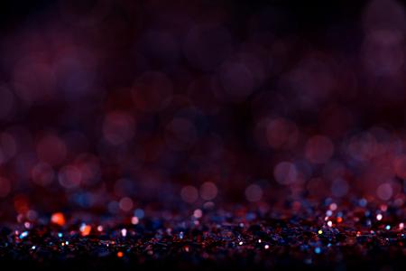 Purple red glitter vintage background lights. Defocused abstract.
