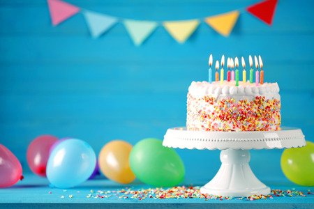 Happy birthday cake with colorful balloons decoration. Birthday card.