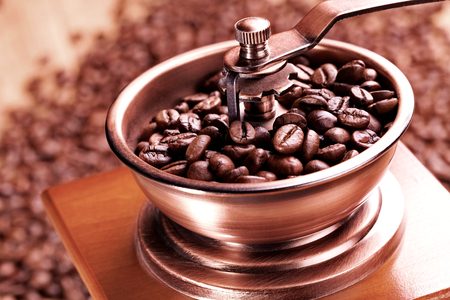 coffee grinder with beans Imagens