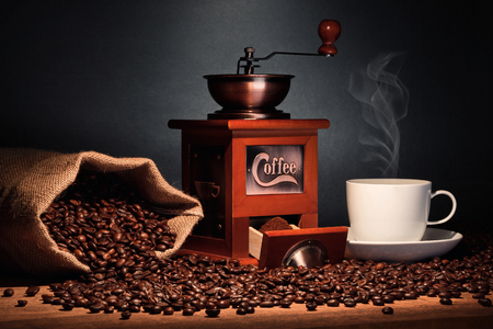 coffee grinder with bean bag and cup