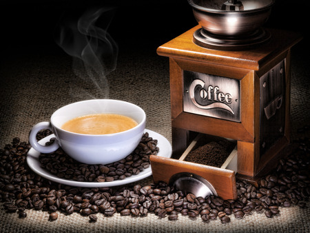 coffee grinder with coffee cup and coffee beans