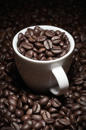 coffee cup with beans Imagens