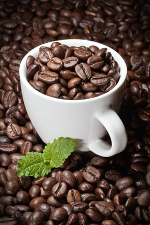 coffee cup with beans and leaf