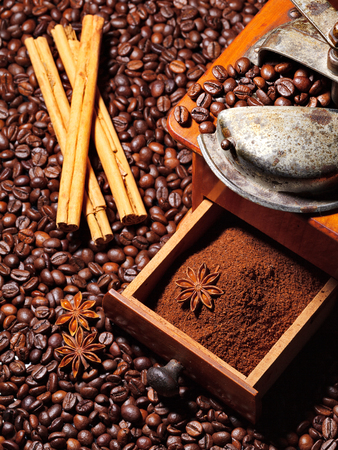 coffee grinder with beans and cinnamon