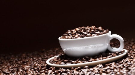 dark coffee cup with coffee beans background