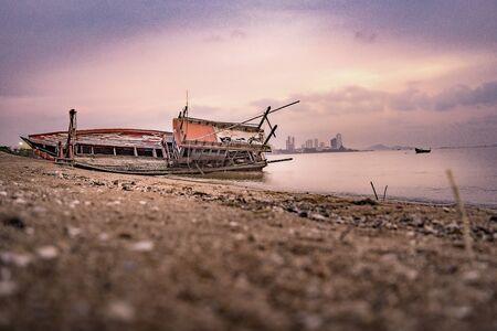 Fishing boat wrecks on the beach