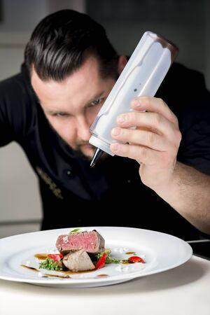 serves: Chef serves steak