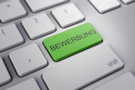 joblessness: Close up view on conceptual keyboard - Bewerbung grenn key