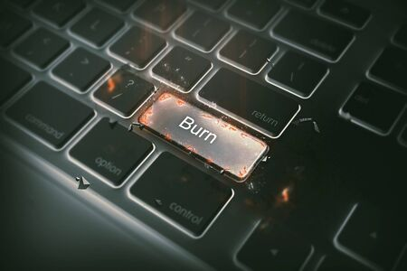 Computer keyboard with burn key. and little fire business concept