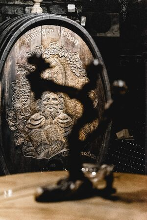 Wine barrels stacked in the old cellar of the winery. Stok Fotoğraf