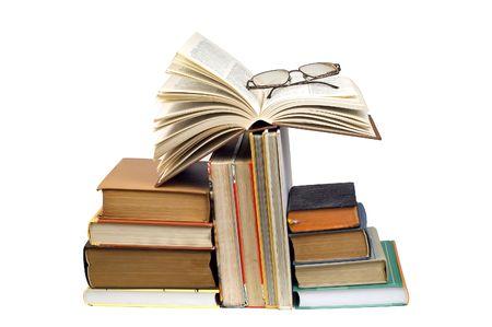 Arangement of books and glasses photo