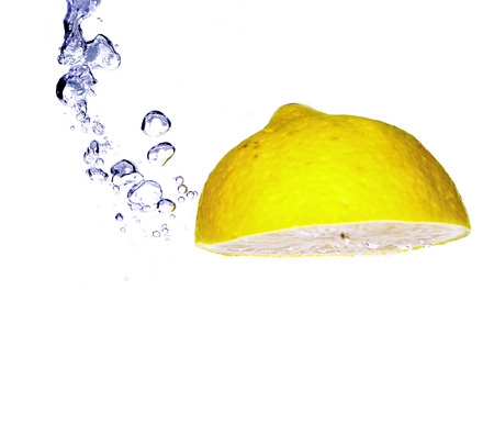 Splash slice of citrus to water Stock Photo