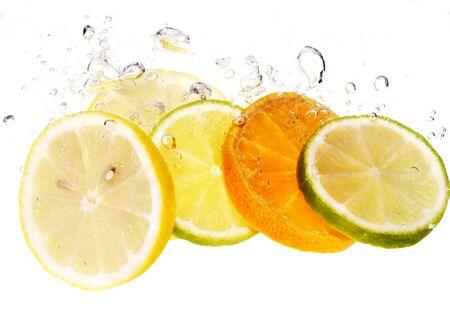 Splash slice of citrus to water Stock Photo