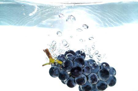 Splash grape to water Stock Photo