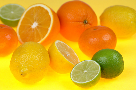 Citrus fruits isolated on yellow