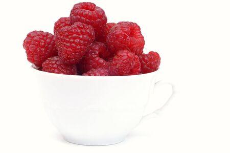 Raspberry on glass  cup photo
