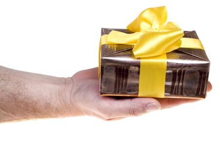 Giving present with yellow ribbon over white Stock Photo - 1862295