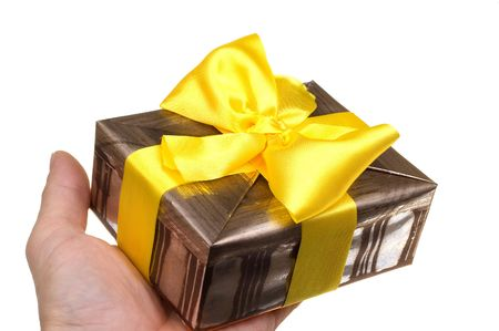 Giving present with yellow ribbon over white Stock Photo - 1862300