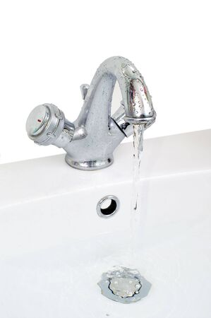 Tap with turn on water in wash-basin photo