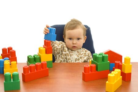 timidity: Cute  girl with colorful blocks isolted background Stock Photo