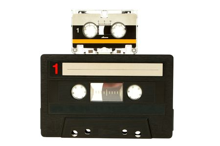 analogue: Big and small cassette tape isolated on white