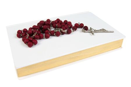 catechism: White prayer book with red rosary isolated on white background