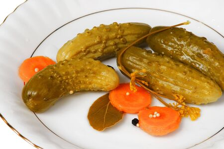 appetize: cucumber gherkins with carrots on white plate