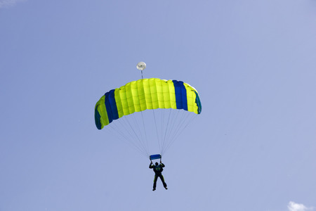 pilotage: Parachutist jumping on a background of blue sky